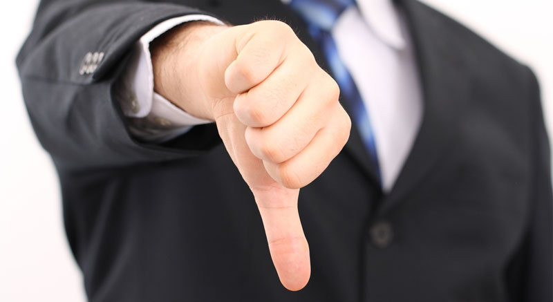 Company business man with hand out and thumb pointed down